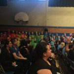 "The whole second grade joins, singing ""It Takes A Rainbow"""